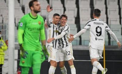 Cristiano Ronaldo (centre) celebrates his opening goal for Juventus against Roma