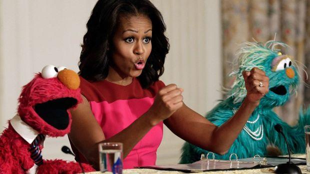 Mrs Obama invited Sesame Street's Elmo (left) and Rosalita to the White House in 2013