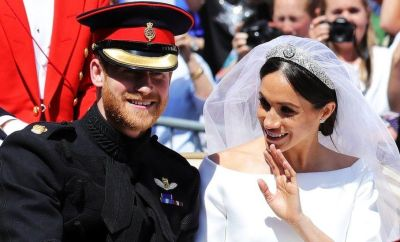 Prince Harry, Duke of Sussex and the Duchess of Sussex in the Ascot Landau carriage during the procession after getting married