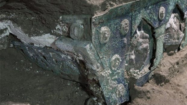 Ornate decoration seen on half-emerged chariott vehicle