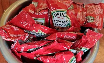Close-up of container of Heinz brand ketchup packets in restaurant setting, Lafayette, California, November 6, 2020.