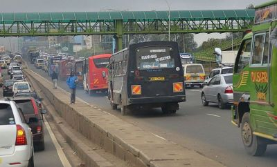 Cars are stuck in traffic on a motorway on October 22, 2014 in the Kenyan capital Nairobi during a typical morning commute.