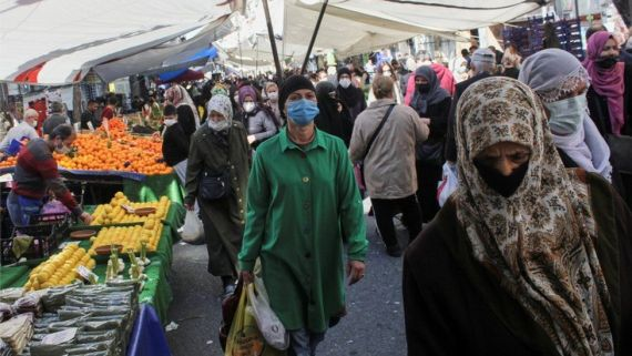 People wearing protective face masks shop at a fresh market in Istanbul, Turkey