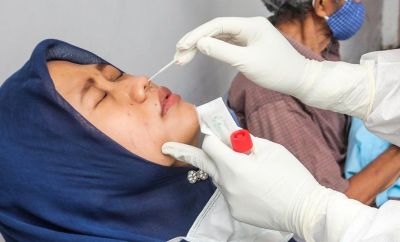 Indonesian woman getting swab test