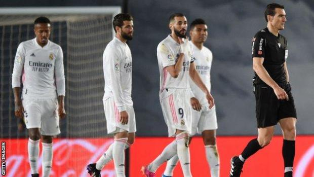 Real Madrid players speak to the referee