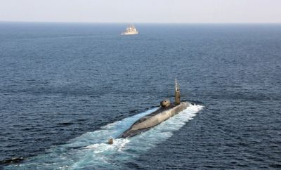The guided-missile submarine USS Georgia transits the Strait of Hormuz with the guided-missile cruisers USS Port Royal and USS Philippine Sea