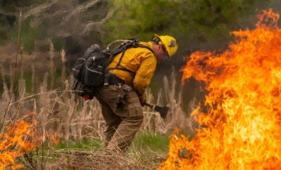A volunteer fire fighter doing training