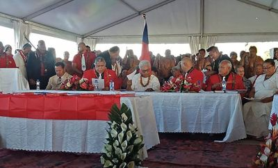 Fiame Naomi Mata'afa (seated C-in white) sits with members of parliament and the judiciary as she is sworn in as Samoa's first woman prime minister in Apia on May 24, 2021, at an extraordinary makeshift tent ceremony after the island nation's long-ruling government refused to cede power and locked the doors of parliament.