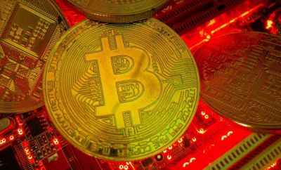 Representations of the cryptocurrency Bitcoin on a motherboard in this picture illustration taken on 20 May 2021