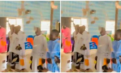 Young boys spray money lavishly in a church while being hailed by members (video)