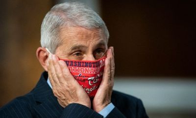 Dr Fauci adjusts his mask