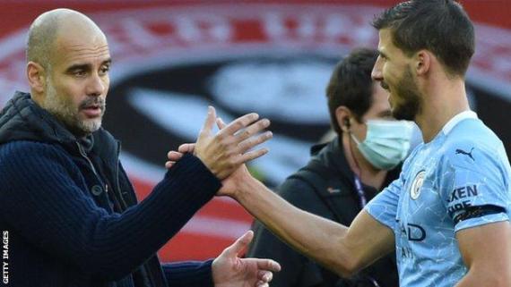 Ruben Dias and Pep Guardiola