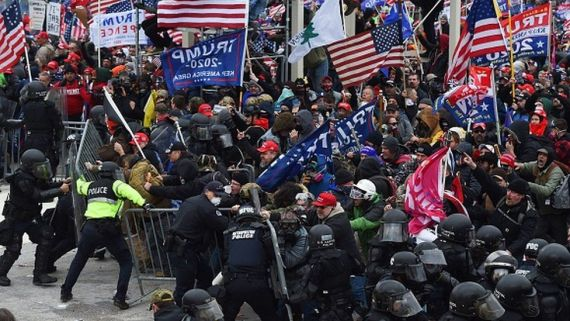 Trump supporters clash with police and security forces as they push barricades to storm the US Capitol