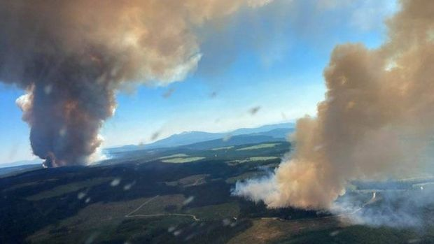 Smoke rises from a wildfire at Long Loch and Derrickson Lake in Central Okanagan, British Columbia, Canada, June 30, 2021
