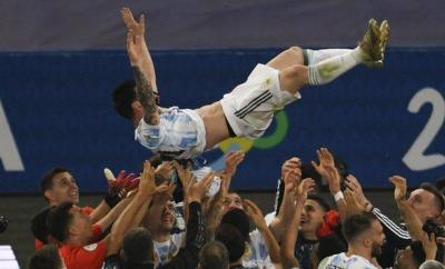 Messi is thrown in the air by his team-mates at full-time
