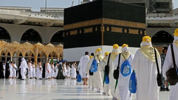Pilgrims arrive at the Kaaba, Islam's holiest shrine, at the Grand mosque in the holy city of Meccca