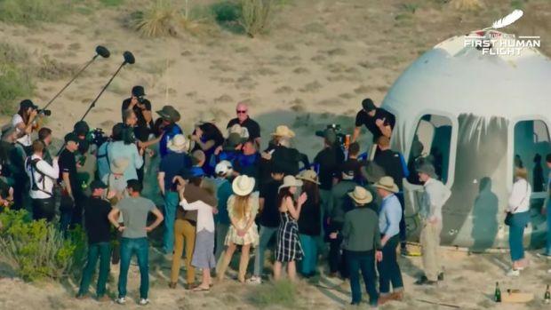 Crowd around New Shepard capsule