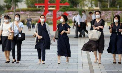 Japanese women wear masks in Tokyo