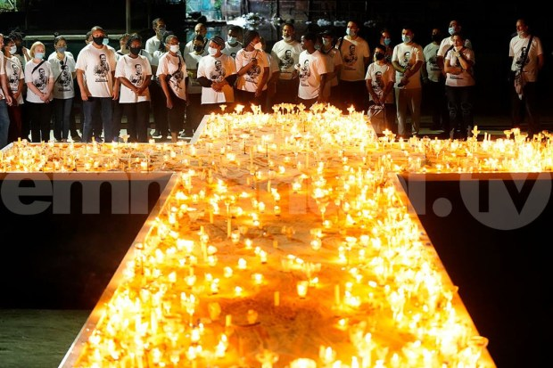 T.B, Joshua?s wife leads candlelight procession for the late televangelist (photos)