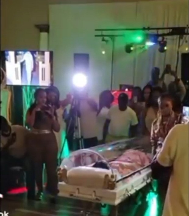 Woman makes entrance in a casket for her 50th birthday party (video)