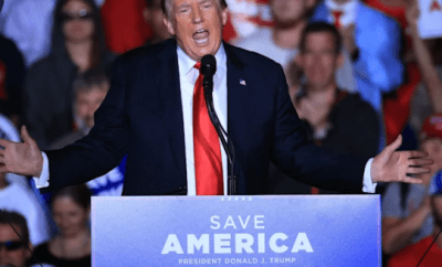 Donald Trump booed at Alabama rally after encouraging his supporters to get the Covid-19 vaccine