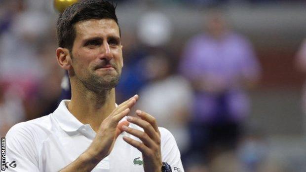 Novak Djokovic applauds the New York crowd