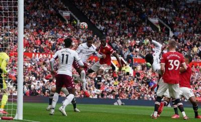 Aston Villa's Ezri Konsa heads over the bar in the match against Manchester United at Old Trafford