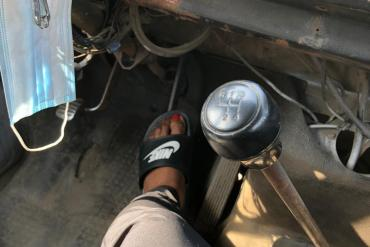 Female passenger pictured stepping on brake of commercial bus after the driver left the bus to fight another road user