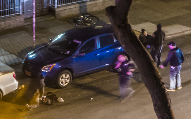 The body of Perez Lopez is between two cars. That may be the knife in the street