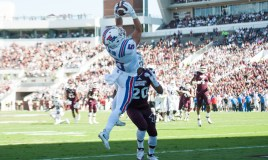 Oct 17, 2015; Starkville, MS, USA; Louisiana Tech Bulldogs wide receiver Trent Taylor (5) jumps over Mississippi State Bulldogs defensive back Brandon Bryant (20) to catch a pass in the end zone during the first half at Davis Wade Stadium. Mandatory Credit: Joshua Lindsey-USA TODAY Sports