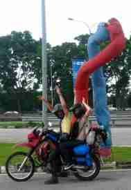 Malaysia-Jules and Kath having fun on the bike