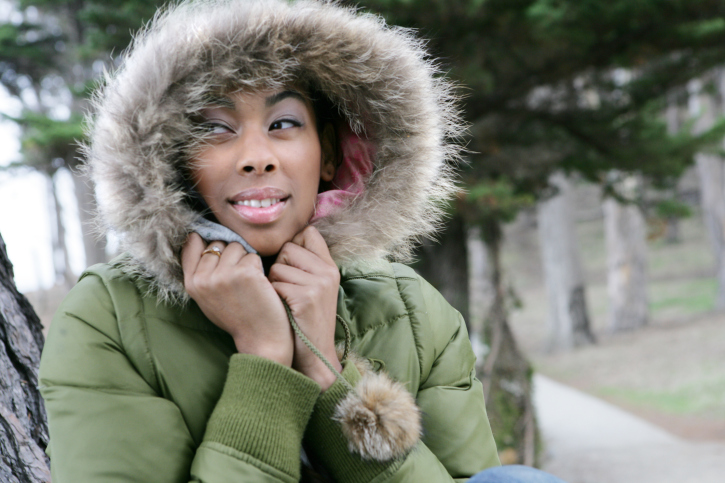 young African American woman in fur hooded coat winter
