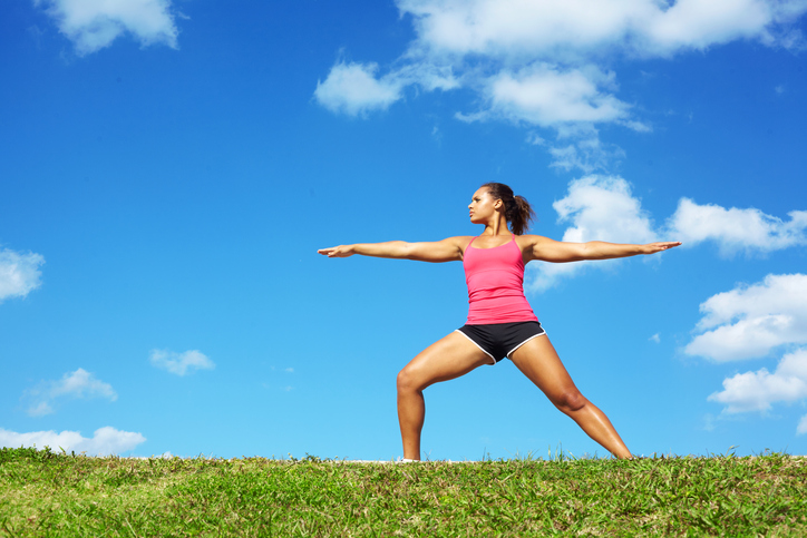 African American woman yoga outside exercise