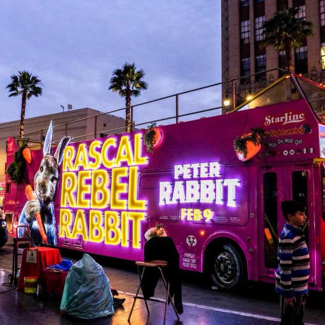 Peter Rabbit illuminated bus at an event