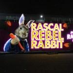 Illuminated Peter Rabbit bus at night