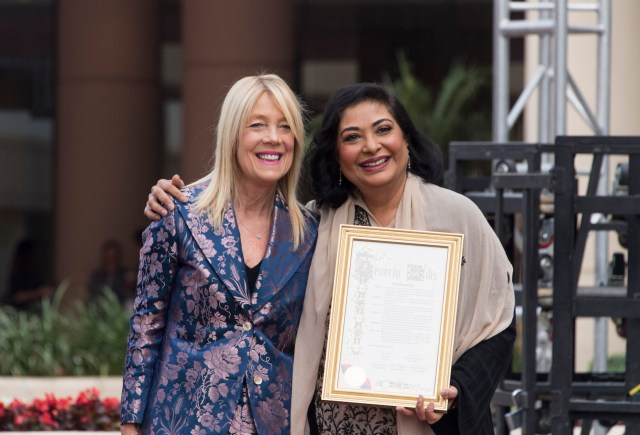 Beverly Hills Mayor Lili Bosse proclaming Janury 7 as the Golden Globe Awards Day with HFPA President Meher Tatna at the Red Carpet Rollout for the 75th Golden Globe Awards 4chion lifestyle