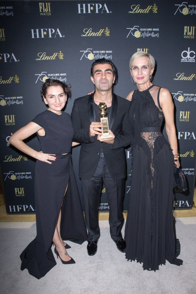 Fatih Akin. Guest, Fatih Akin and guest pose with the award backstage at the 75th Annual Golden Globe Awards 4chion lifestyle