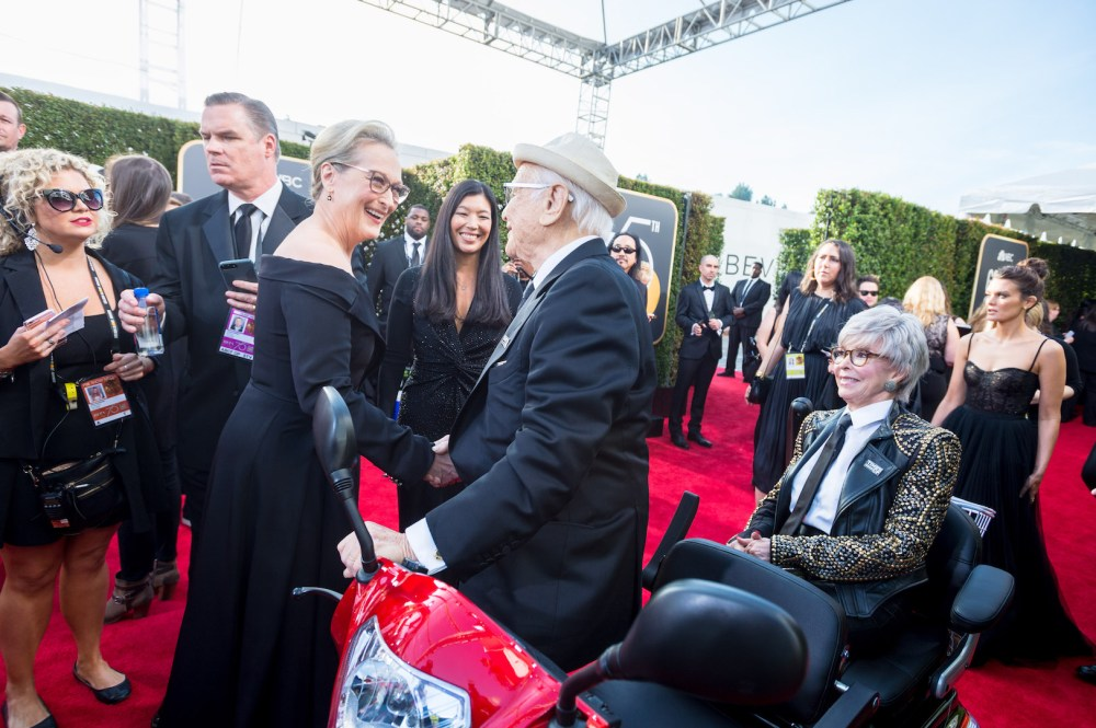 Meryl Streep greets Norman Lear and Rita Moreno on the red carpet of the 75th Annual Golden Globe Awards 4chion lifestyle