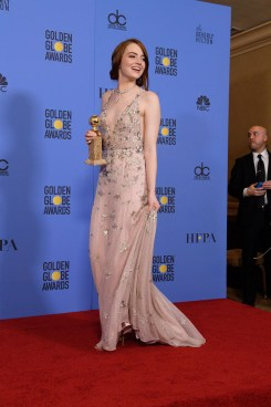 """After winning the category of BEST PERFORMANCE BY AN ACTRESS IN A MOTION PICTURE – COMEDY OR MUSICAL for her work in """"La La Land,"""" actress Emma Stone poses backstage in the press room with her Golden Globe Award at the 74th Annual Golden Globe Awards at the Beverly Hilton in Beverly Hills, CA on Sunday, January 8, 2017."""