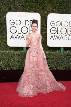 """Nominated for BEST PERFORMANCE BY AN ACTRESS IN A MOTION PICTURE – COMEDY OR MUSICAL for her role in """"Rules Don't Apply,"""" actress Lily Collins attends the 74th Annual Golden Globes Awards at the Beverly Hilton in Beverly Hills, CA on Sunday, January 8, 2017."""