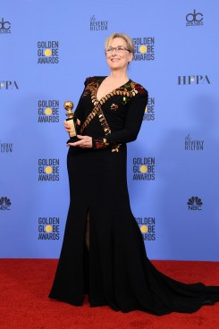 """Meryl Streep poses backstage in the press room with the Cecil B. DeMille Award for her """"outstanding contribution to the entertainment field"""" at the 74th Annual Golden Globe Awards at the Beverly Hilton in Beverly Hills, CA on January 8, 2017."""