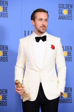 """After winning the category of BEST PERFORMANCE BY AN ACTOR IN A MOTION PICTURE – COMEDY OR MUSICAL for his work in """"La La Land,"""" actor Ryan Gosling poses backstage in the press room with his Golden Globe Award at the 74th Annual Golden Globe Awards at the Beverly Hilton in Beverly Hills, CA on Sunday, January 8, 2017."""