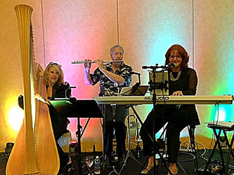 Sherri Williams, Margaret Atkinson and flutist at Gaylord Texan May 14, 2016