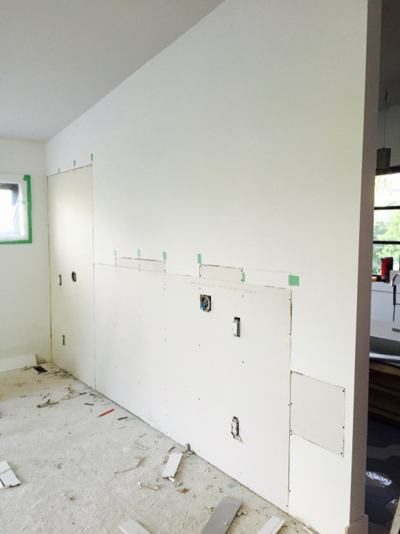 Unfinished wall on opposite side of vanity wall