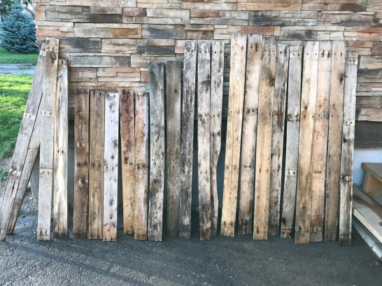 Reclaimed pallet wood boards cleaned & drying