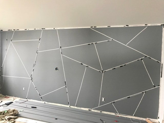 Geometric feature wall all wired up with LED tape lights