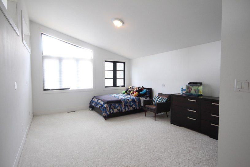 Boys bedroom before: a big black canvas space lacking colour or personality