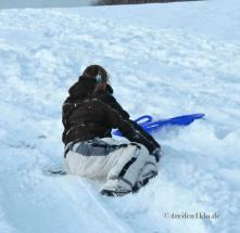 winter-schlitten fahren-sturz