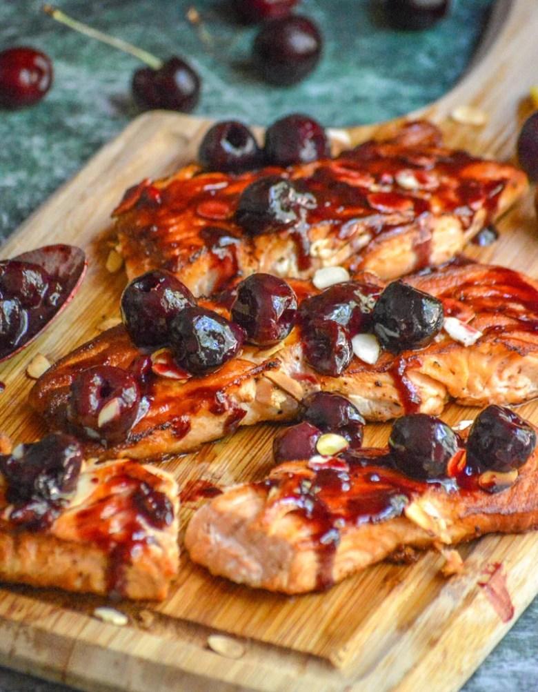 seasonal fresh salmon recipe using fresh cherries and a sweet almond glaze
