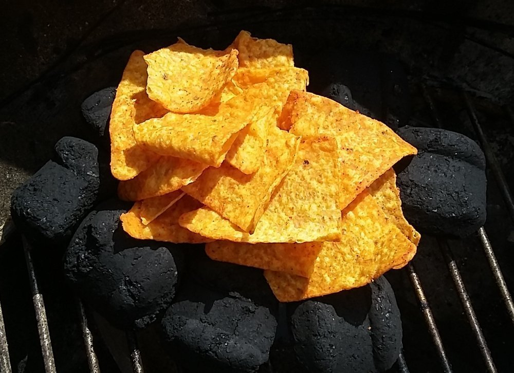 bed of charcoal with Doritos on top